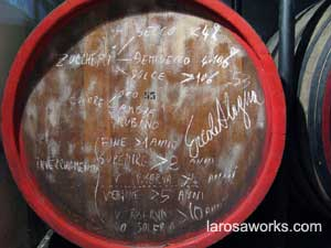 Ercole's wine making recipe, signed and delivered to us on a wine barrel.